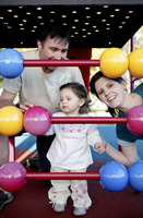 Parents and daughter playing with abacus in the playground