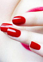 Red coloured finger nails