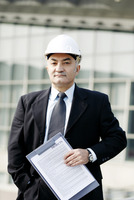 Senior businessman wearing a safety helmet
