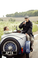 Senior couple drinking wine in the car
