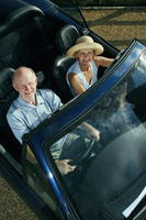 Senior couple travelling together in the car
