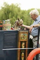 Senior man and dog on the houseboat