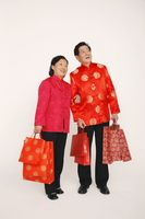Senior man and woman holding shopping bags