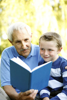 Senior man reading for his grandson