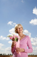 Senior woman holding a bouquet of flowers