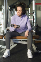 Senior woman weightlifting with dumbbell
