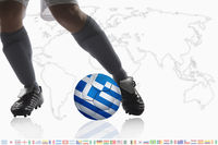 Soccer player dribble a soccer ball with greece flag