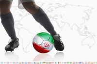Soccer player dribble a soccer ball with iran flag