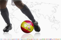 Soccer player dribble a soccer ball with spain flag
