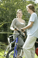 Teenage couple with their bicycles