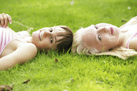 Teenage girls lying on the field