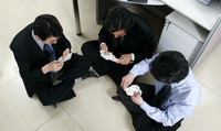 Top view of three men playing cards in the office