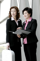 Two business women discussing a project