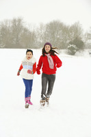 Two girls having fun in the snow