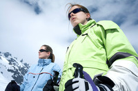 Two women getting ready for snow skiing