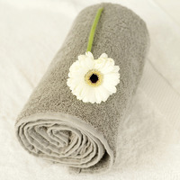 White flower on a rolled up towel
