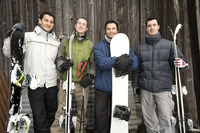 Winter sport players with their skis and snowboards