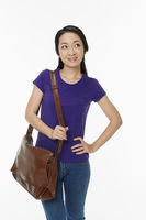 Woman carrying a brown sling bag
