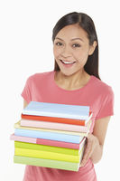 Woman carrying a stack of books