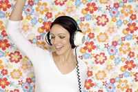 Woman dancing while listening to music on the headphones