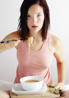 Woman eating a bowl of noodles