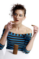 Woman eating biscuits