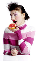Woman eating blood orange