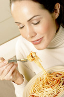 Woman enjoying a bowl of spaghetti