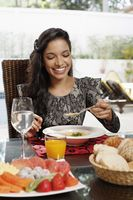 Woman enjoying pumpkin soup