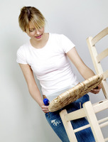Woman fixing a broken chair