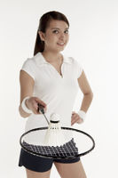 Woman holding a badminton racket with shuttlecock placed on it
