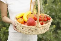 Woman holding a basket of fruits