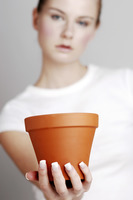 Woman holding a flower pot