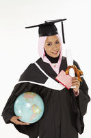 Woman holding a globe, passport and a graduation scroll