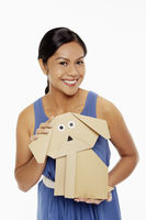 Woman holding a paper dog