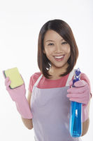 Woman holding a sponge and spray bottle