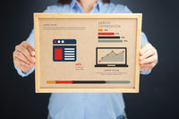 Popular : Woman holding board with website optimization concept and infographics
