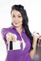 Woman holding out credit card