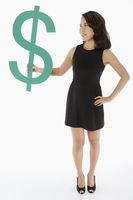 Woman holding up a dollar sign
