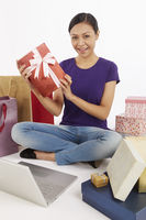 Woman holding up a gift box