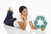 Woman holding up a recycle logo