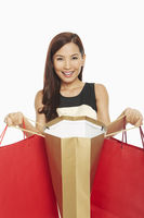Woman holding up her shopping bags