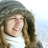 Woman in hooded jacket smiling