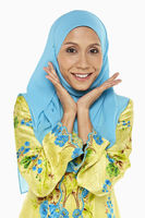 Woman in malay traditional clothing, smiling