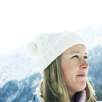 Woman in white knitted hat looking away
