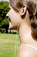 Woman listening to music while jogging in the park