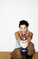 Woman pointing a drill at the camera