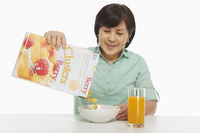 Woman pouring cereals into bowl