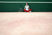 Woman sitting in the tennis court