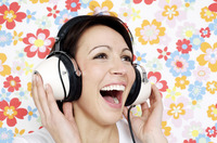 Woman smiling while listening to music on the headphones